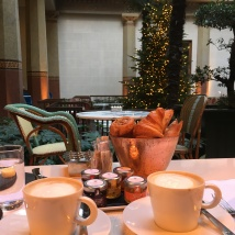 Coffee and pastries in the hotel courtyard, complete with a palm tree all decked out for the holidays.